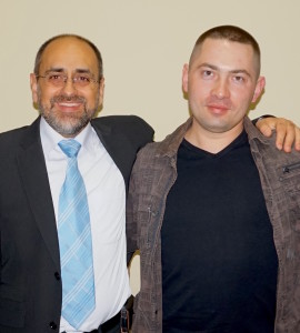Sergei (pictured with Eliezer) is grateful for the impact the Gospel has had on his life.